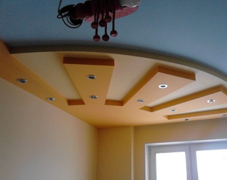 Дизайн в виде солнца в интерьере детской комнаты