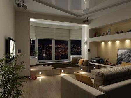 Если сделать подиум, а потолок оформить другим материалом, выступ в гостиной станет отдельным спальным местом или обеденной зоной