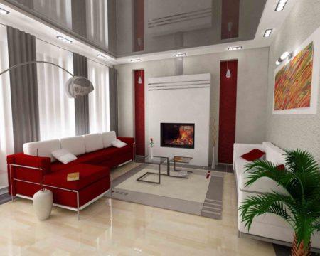 Фото интересного оформления небольшой гостиной, где серый цвет присутствует на потолке, стенах и текстиле, а также комбинируется с красными и белыми тонами